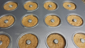 Pumpkin spiced doughnuts smoothed down and ready to go into the oven.