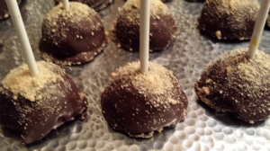 Little pops of creamy pumpkin cheesecake wrapped in chocolate like a litle present.
