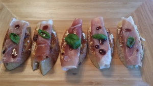 A simple and elegant appetizer - Crostini with fig jam, prosciutto, basil and balsamic.